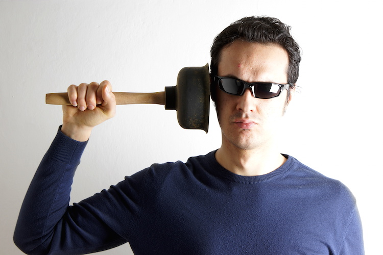 Man with plunger